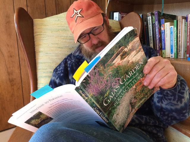 Colby reading Gaia's Garden