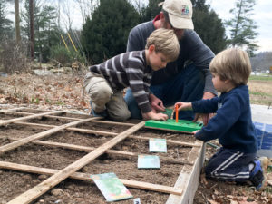 Colby and boys planting in early spring